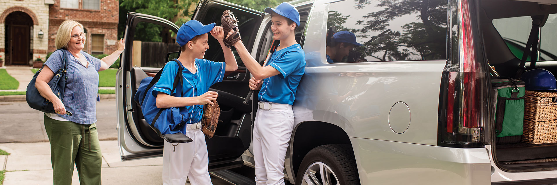 Mom taking sons to baseball game