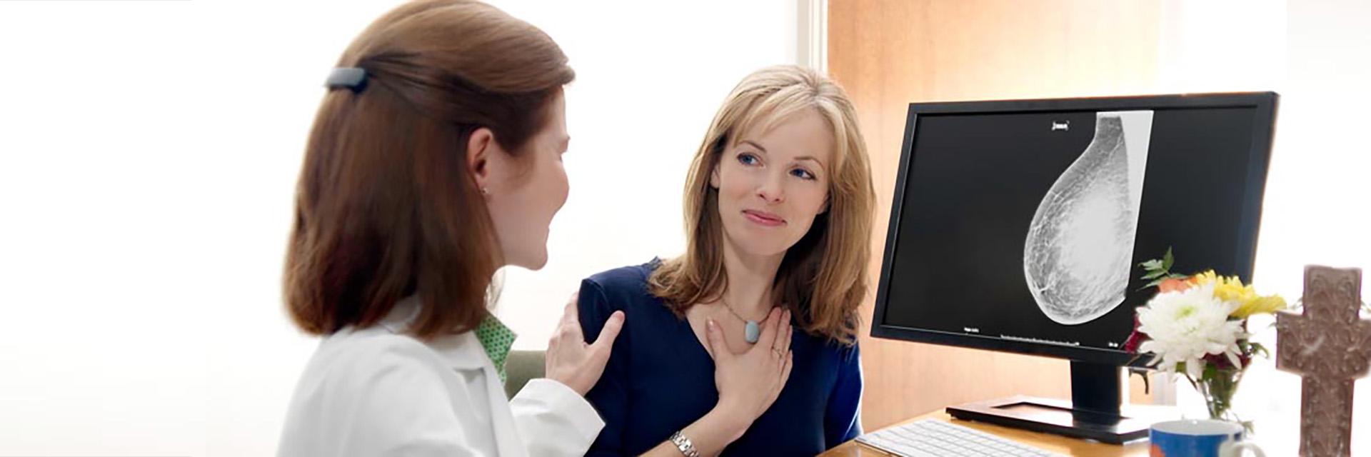 Doctor and Patient Reviewing Mammogram