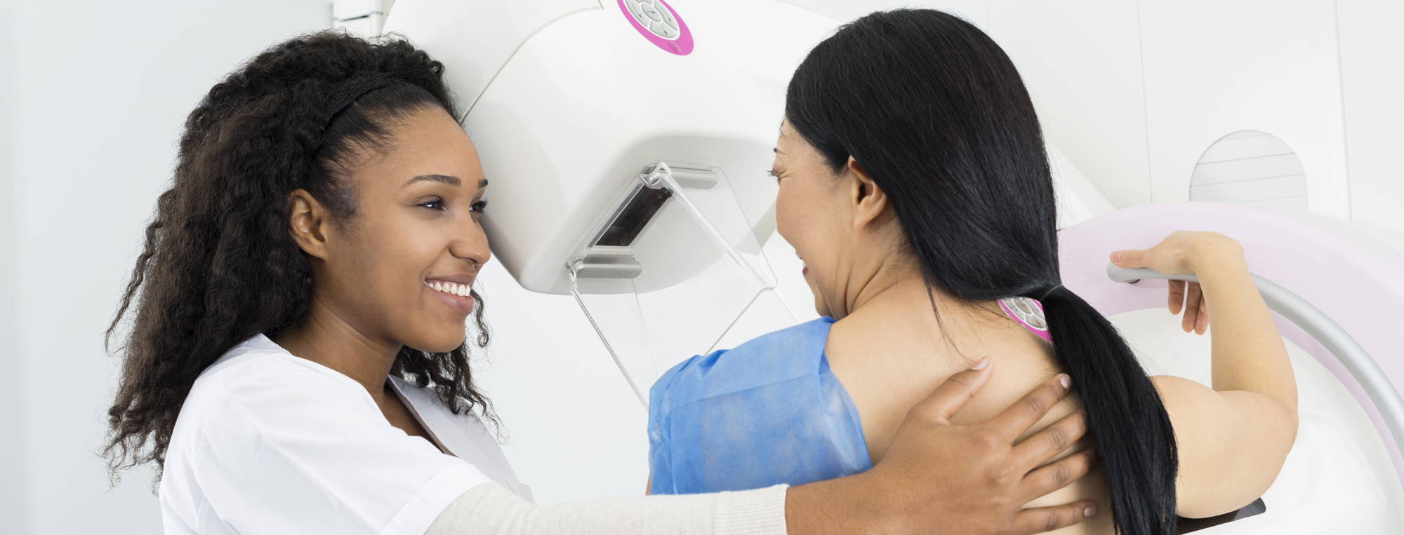 Female doctor giving patient mammogram