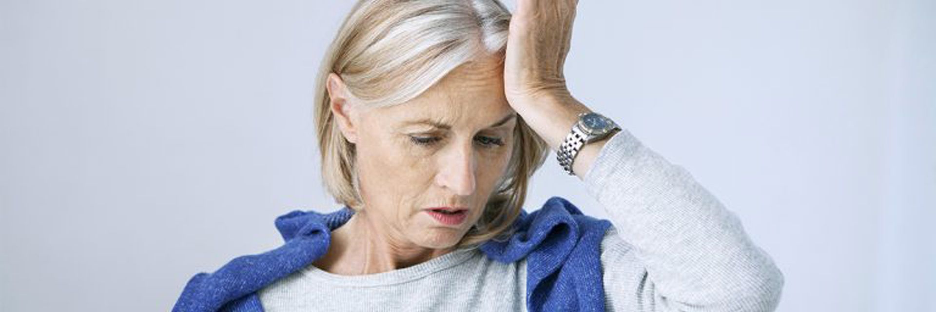 Mature woman holding her head