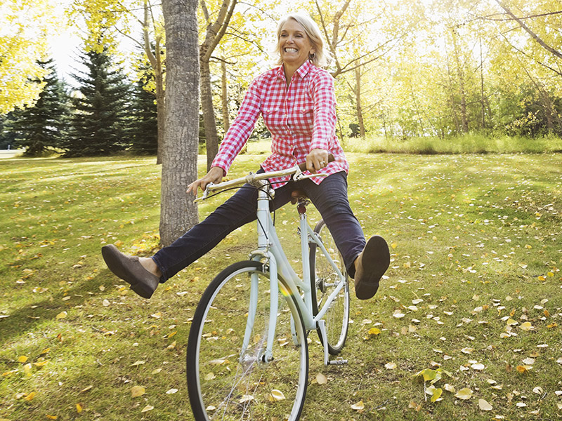 Woman having fun riding her bicycle