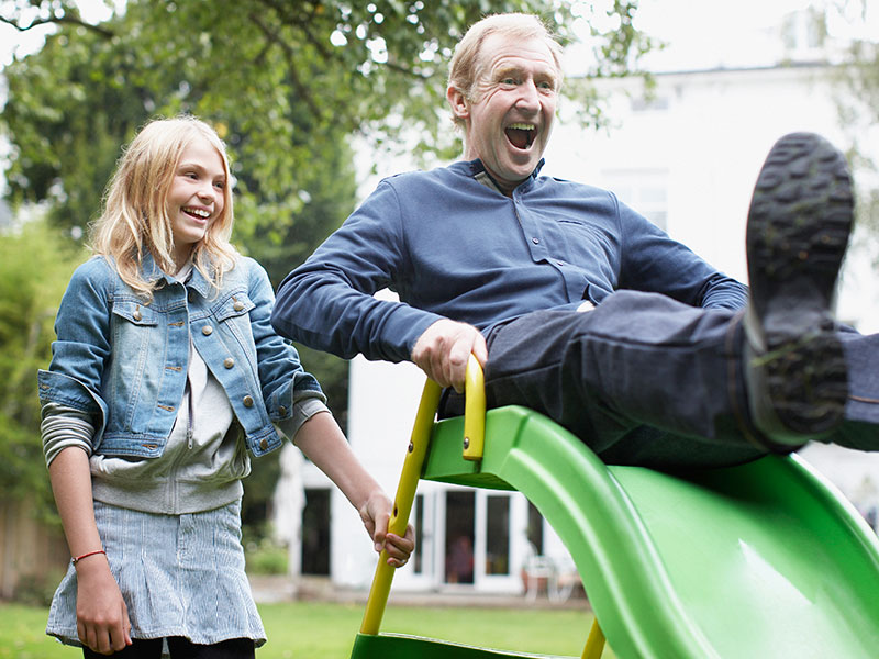 Girl with Grandpa on Slide